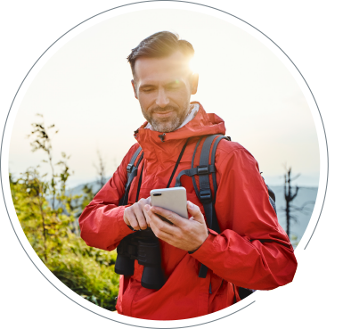 Man using online banking outdoors