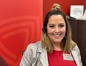 Woman with headset in front of red background