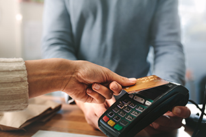 Person processing a card payment at a card processor