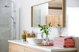 Large mirror over vessel sink in modern bathroom