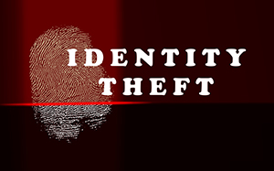 Identity theft concept with thumb print and red scanner lights
